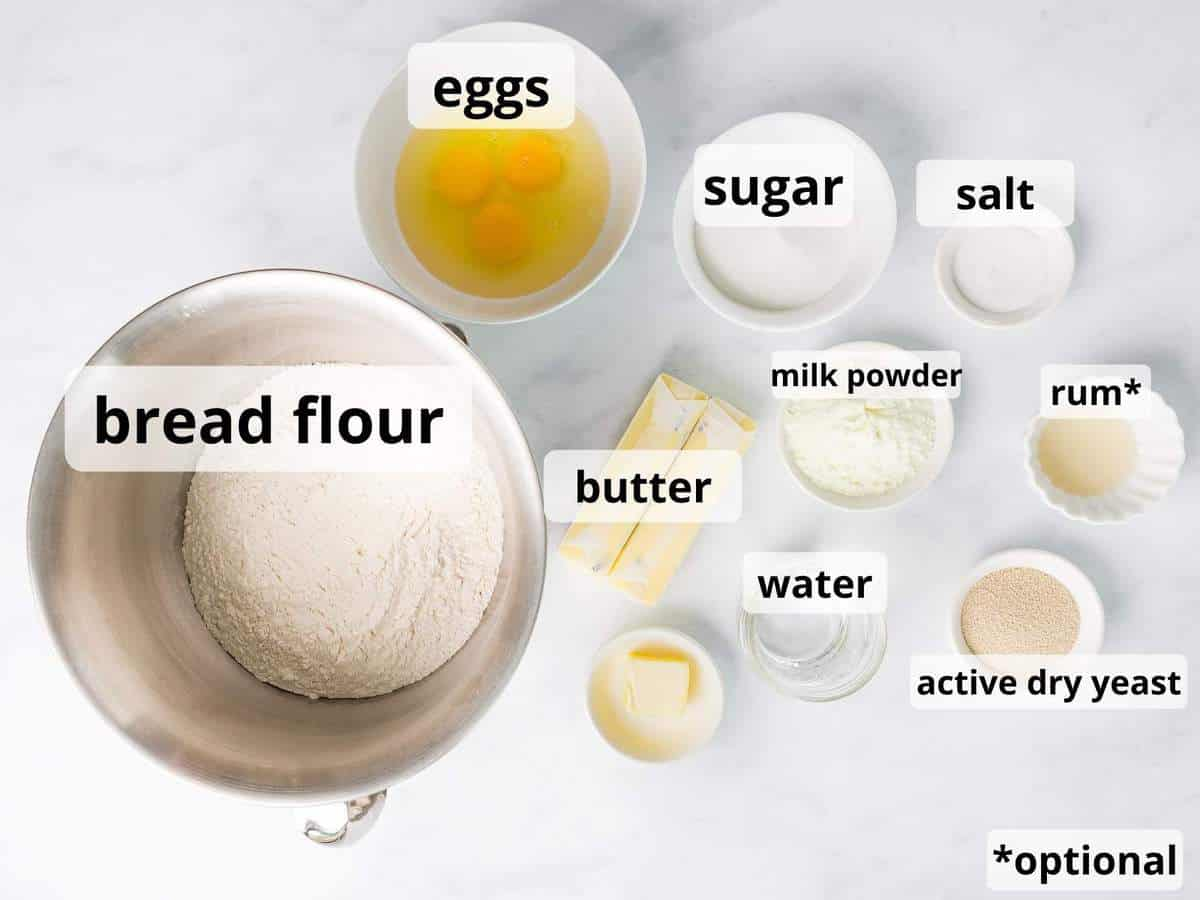 Ingredients for brioche rolls in small bowls with text overlay.