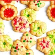 Christmas cookie press cookies with sprinkles.