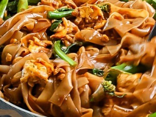 Pad see ew noodles being caramelized with sauce.