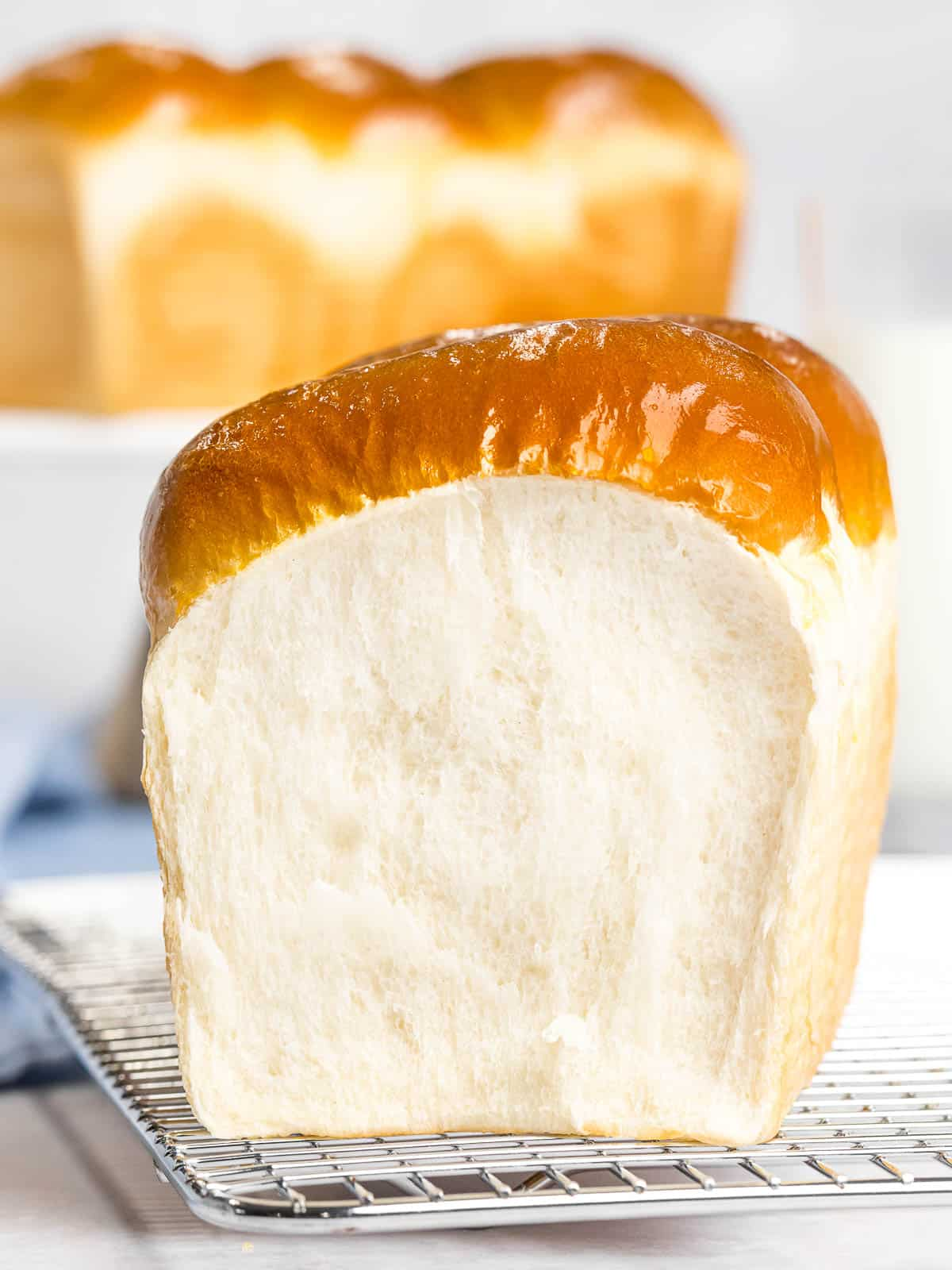 Japanese milk bread with soft, fluffy, light crumb and golden brown crust.