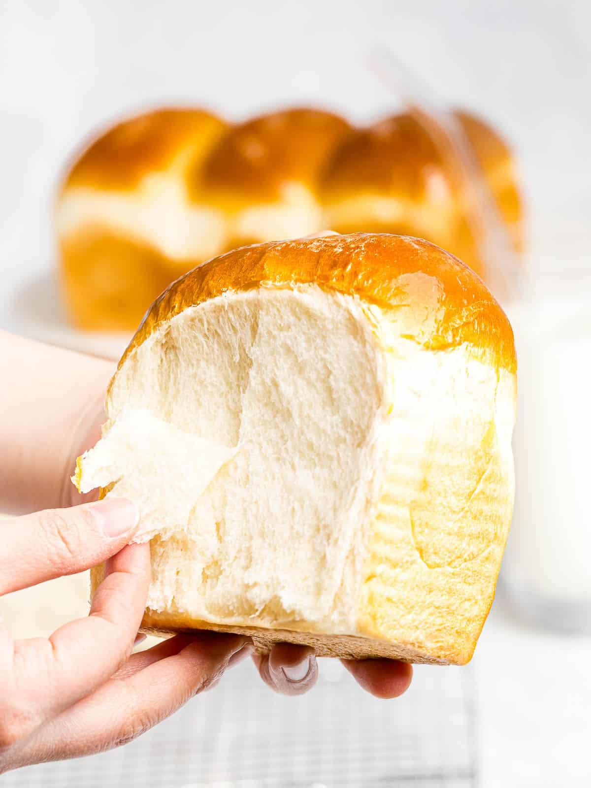 Korean milk bread pulled apart by hands to show proper gluten development.