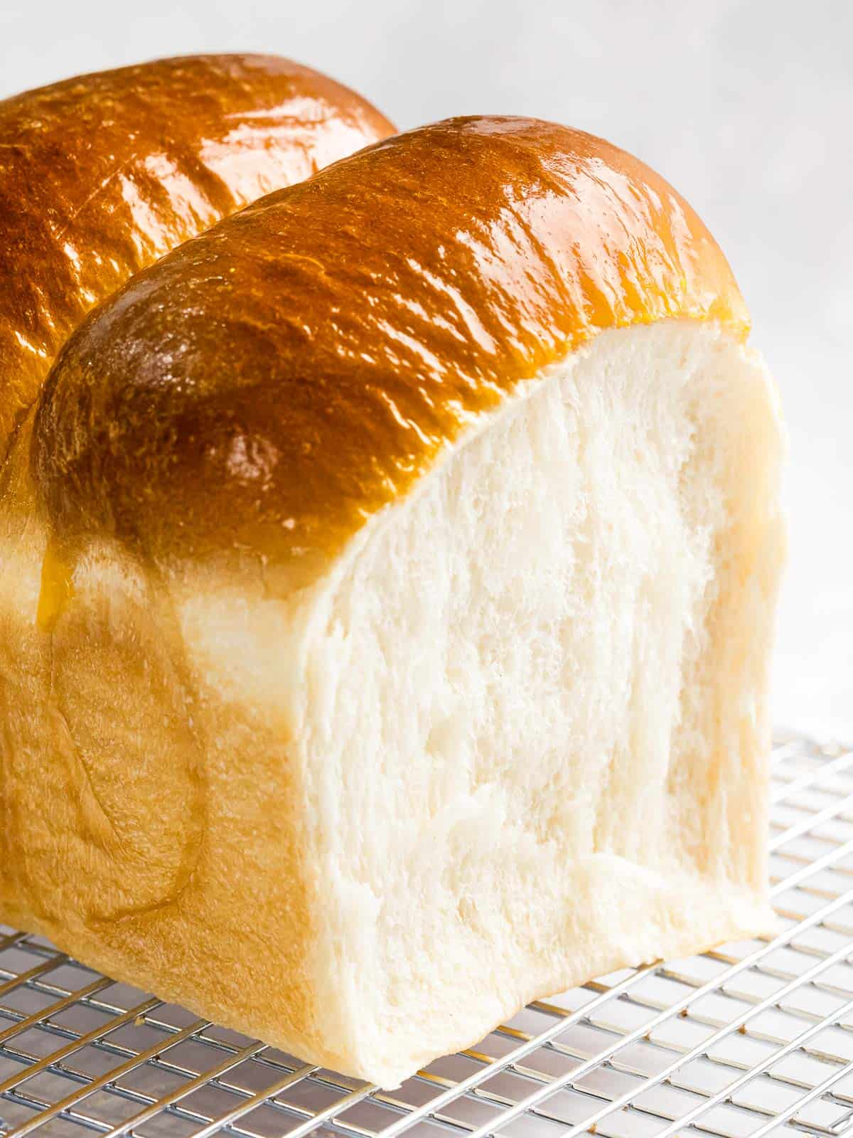 Japanese milk bread or shokupan with soft, fluffy crumb and golden brown crust.