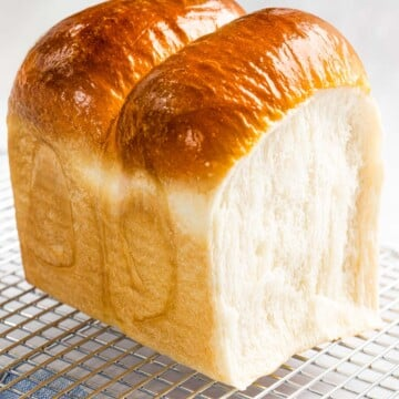 Soft and fluffy milk bread (shokupan) with golden crust.