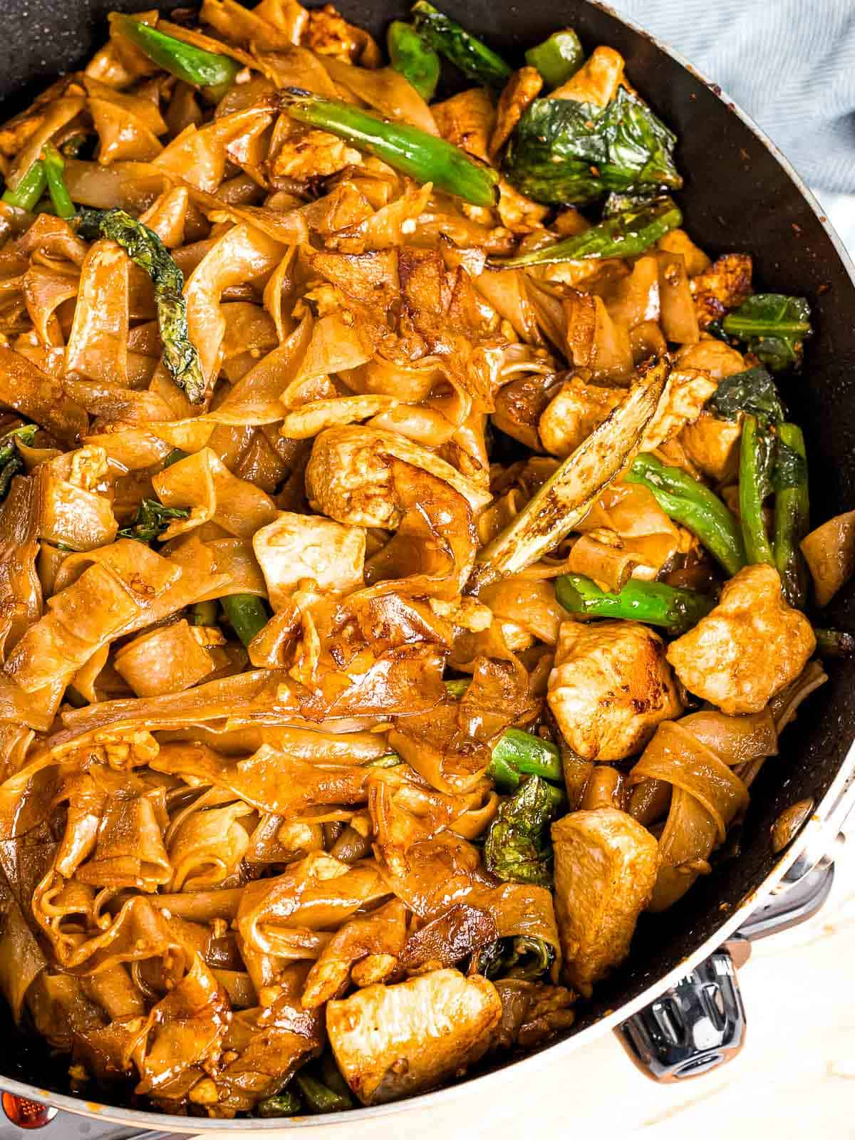 Perfectly cooked pad see ew with slightly caramelized noodles and charring.