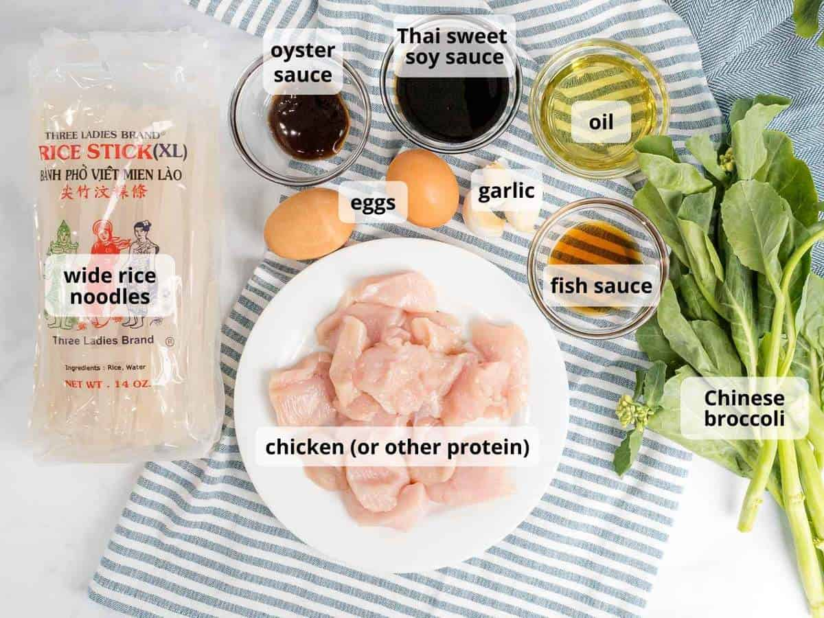 Ingredients for pad see ew with labels including rice noodles, Thai sweet soy sauce, chicken, and broccoli.