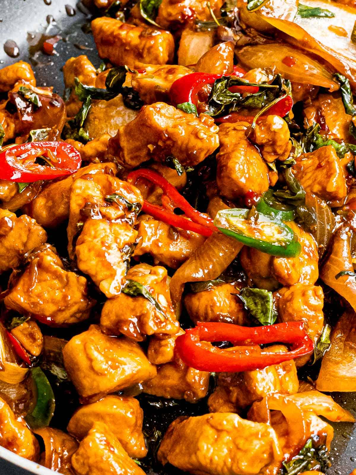 Thai basil chicken stir fry with chili pepper slices.