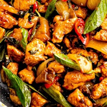 Thai basil chicken with red chili pepper slices.
