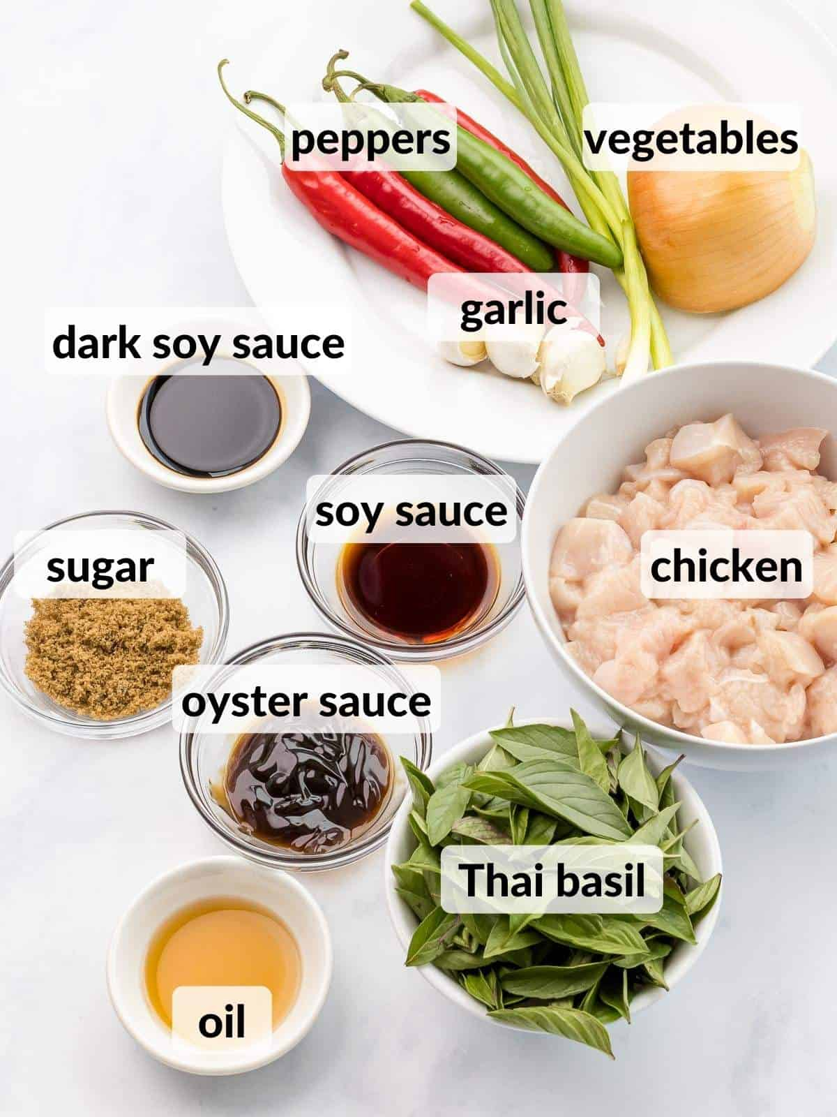 Ingredients for Thai basil chicken in small bowls.
